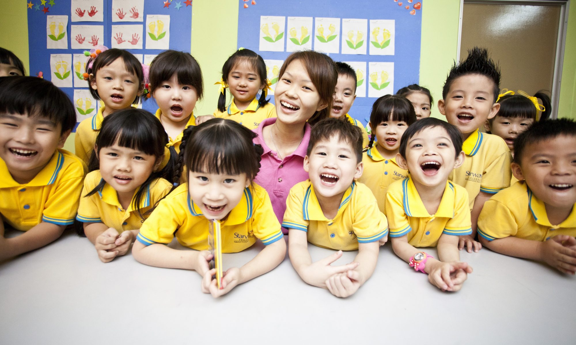 kindergarten kids with a female teacher